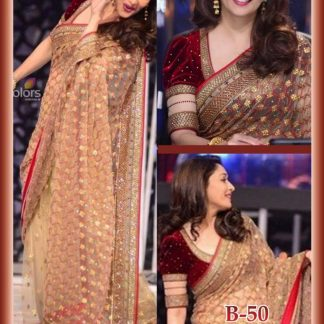 Stunning Actress Madhuri Dixit Wearing Light Orange Net Saree-0