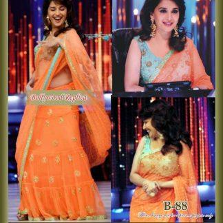 Beautiful Actress Madhuri Wearing an Orange Lehenga-0