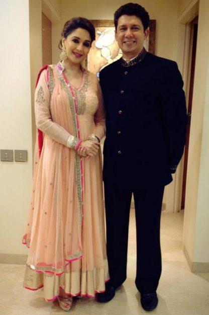 Madhuri Dixit Wearing a Light Peach Semi Stitched Salwar Kameez-0